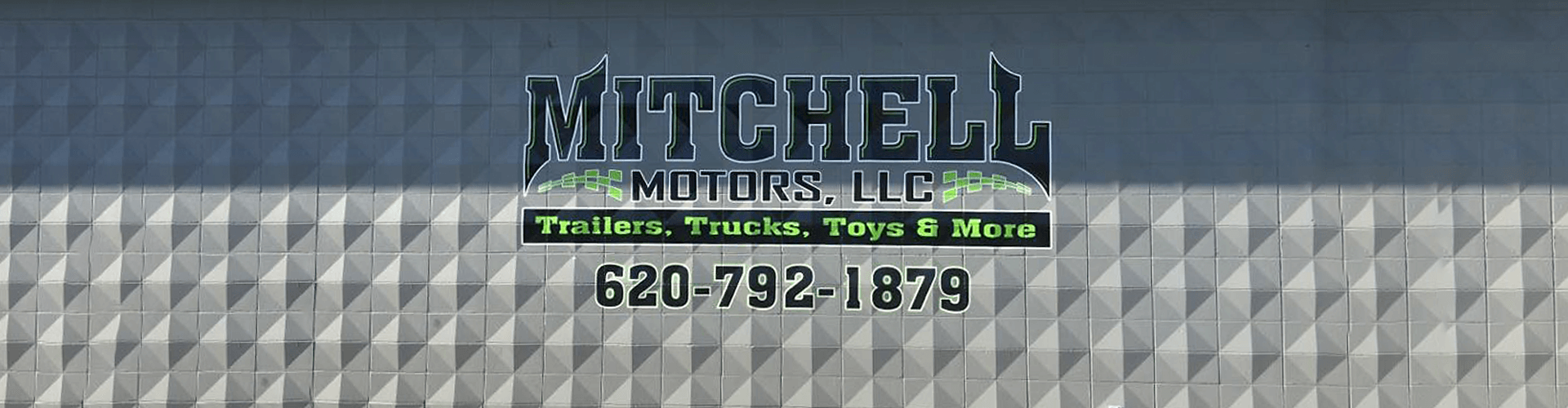 Mitchell Motors logo on patterned cement wall